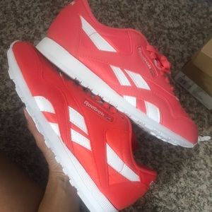 One pair of red One pair of pink Reebok Classics